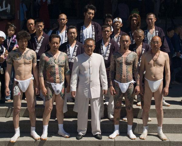 Yakuza displaying their tattoos during Sanja Festival