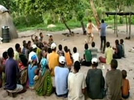 Eric Bouvron Entertains the Bushmen Children in Africa
