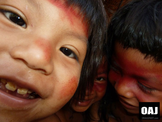 Kids play. Three kids from the Huaorani, Apaka village, play and pose.