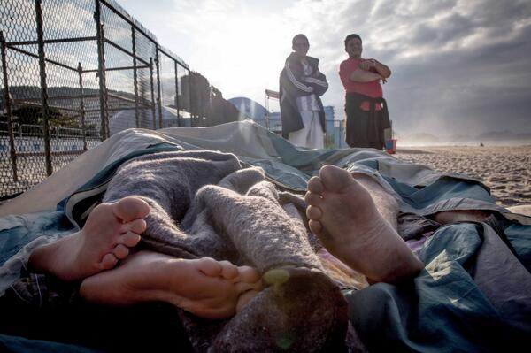 world cup fans sleep in beach in rio, brazil